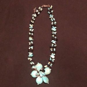Turquoise beaded floral necklace.